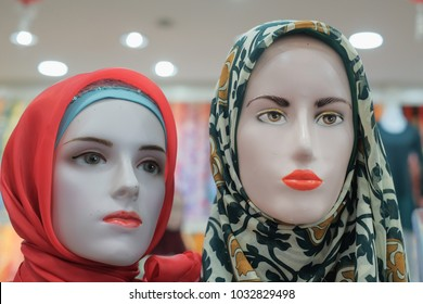 Head mannequins with traditional Muslim shawls in  JAKEL Boutique store. Traditional wears for Malaysian.