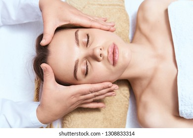 head massage woman with closed eyes relax