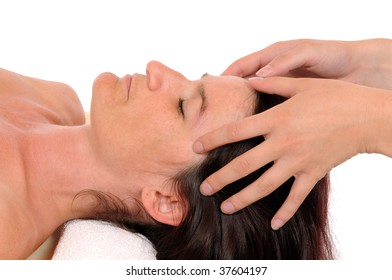 Head massage of a young woman in front of a white background