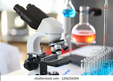 Head microscope on the background laboratory is a study human biology analyzes for non-compliance with the requirements organization public health at international level