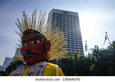 head of ondel ondel with the background of an office building on Sudirman Street, Jakarta. Ondel-ondel is a large puppet figure featured in Betawi folk performance of Jakarta, Indonesia.