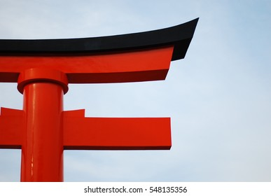 Head of pillar in black and red color and clear sky as background in Kyoto Japan