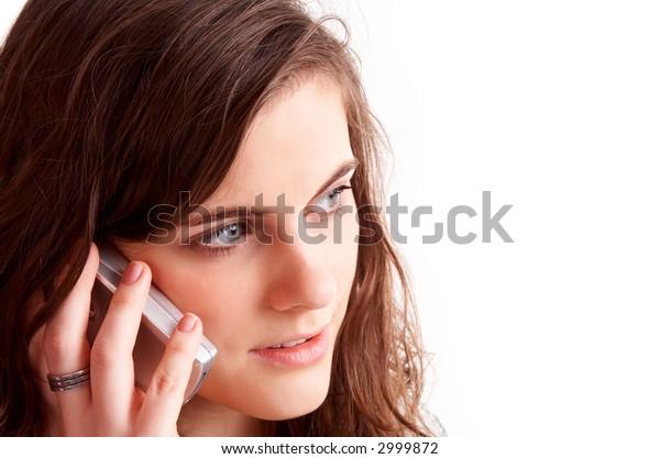 Head portrait of a pretty girl talking on cellphone