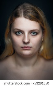 Head portrait of a young blond woman