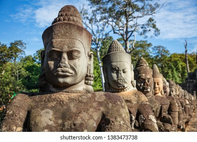 Head sculptures on the bridge leading to the south gate at Angkor Thom temple complex, Siem Reap, Cambodia