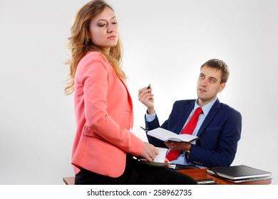 Head and secretary talking in the office.The secretary closed her eyes and holding a cup of coffee.Head obesnyaet, she does not want to listen.