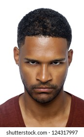 Head shot of an angry African-american man looking sharply towards the camera