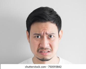 Head shot of angry face Asian man.