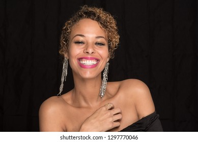 Head Shot of a Beautiful Woman Laughing - Isolated on Black