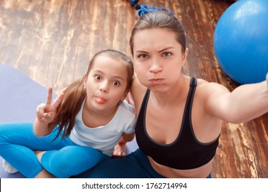 Head shot funny fools faces, mom and daughter close up. Selfie picture photo on mobile phone. Digital advertising, family values. Creative social concept exemplary family, happy shine, light life cute