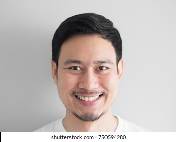 Head shot of happy face Asian man.