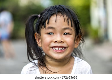 Head shot of little girl with big smile