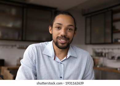 Head shot portrait close up African American man speaking at camera, mentor teacher leading online lesson, blogger shooting vlog, businessman making video call, chatting, involved in internet meeting