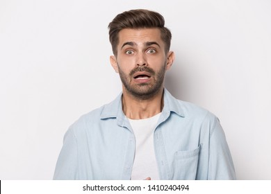 Head shot portrait emotional guy feeling sinking heart shortness of breath about emotional stress sensations isolated on grey white studio background, frightened person, horror, panic attack concept
