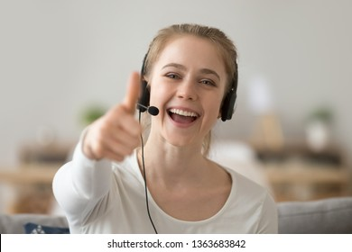 Head shot portrait happy smiling woman, support operator in headset show thumbs up, excited female student like, recommend distance learning languages, educational course, looking at camera