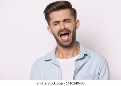 Head shot portrait of hysterical face expressions guy closed eyes screaming or whines isolated on grey white studio background, nagging man feeling desperate, singer singing song expressively concept