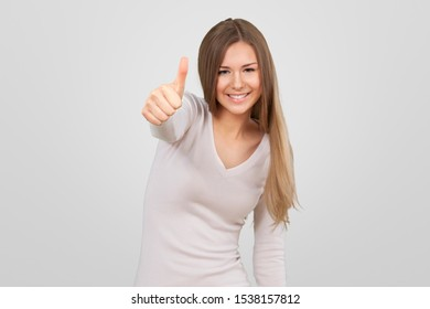 Head shot portrait young 20s woman having wide white smile wearing t-shirt looking at camera, pretty female advertise good offer teeth whitening in dental clinic posing isolated on grey background