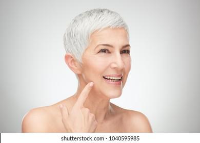 Head shot of senior woman showing wrinkles.