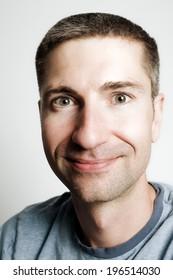 Head shot of a smiling man in his late twenties.