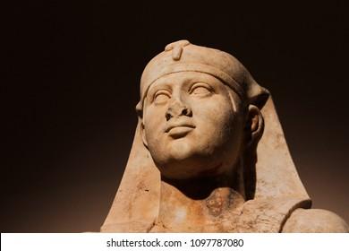 Head shot of a statue of Egyptian-Roman god Osiris in low-key lightning