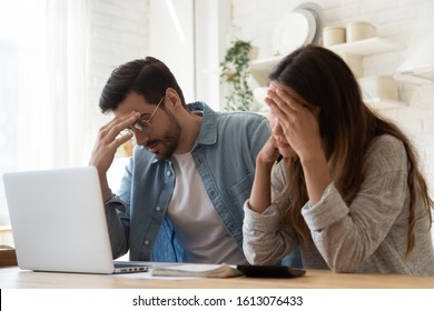 Head shot stressed young family couple feeling disappointed by high utility bills, money loss. Unhappy nervous married spouse received debt mortgage notification, checking financial documents.