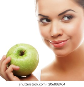 Head shot of woman holding green apple against white background