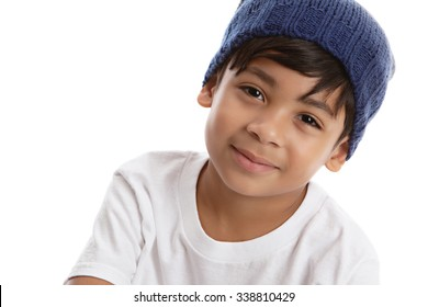 Head shot of a young male model wearing a knit ht and white tee shirt.  Isolated on white with room for your text.