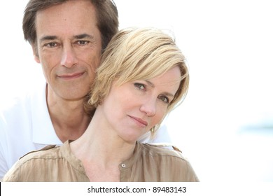 Head and shoulders of mature couple
