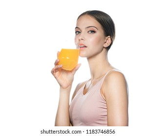 head and shoulders portrait of attractive young caucasian  woman isolated on white studio shot drinking orange juice face skin klookıng at camera