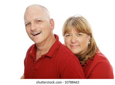 Head and shoulders portrait of a happy mature couple.  Isolated on white.