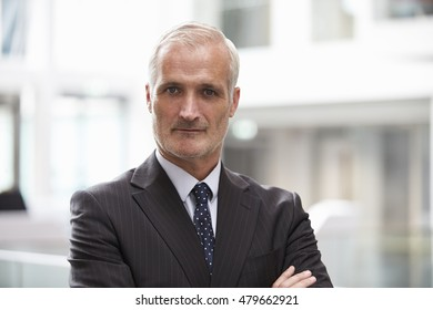 Head And Shoulders Portrait Of Mature Businessman In Office