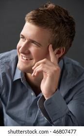 Head And Shoulders Portrait Of Young Man In Studio