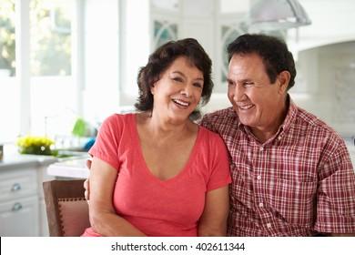 Head And Shoulders Shot Of Senior Hispanic Couple At Home