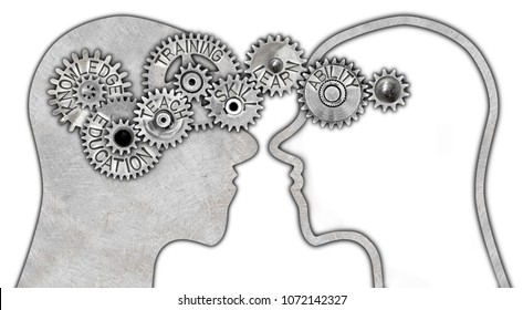 Head silhouette and tooth wheels with knowledge transfer and education concept related words imprinted on metal surface isolated on white