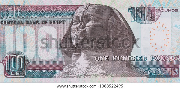 Head of the Sphinx statue, Mask of Pharaoh King Tutankhamoun. portrait  on 100 POUNDS (Egyptian Pound) Year 2012 or 2012 Image Sultan Hussein Mosque Behind the Sphinx, Closeup Collection.