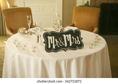 Head table for bride and groom at wedding.