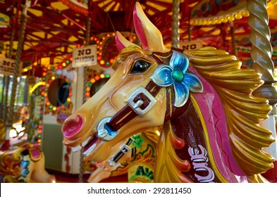 Head of a vintage horse  of amusement ride on merry-go-round carousel.  Amusement concept