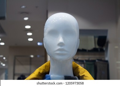 Head of a white mannequin at store background