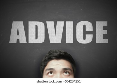 Head with white text Advice against blackboard background.
