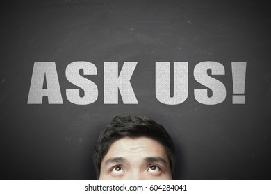Head with white text Ask Us against blackboard background.