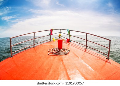 Head of wooden boat running to the sea, Boat bow sailing in blue sea in summer vacation.