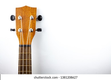 head of a wooden ukulele isolated with copy space