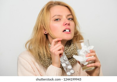 Headache and cold remedies. Woman tousled hair scarf hold tablets blister. Flu and cold concept. Take medications to get rid of cold. Guidelines for treating cold. Girl take medicine drink water.