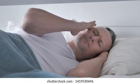 Headache, Depressed Restless Gray Hair Man Sleeping in Bed