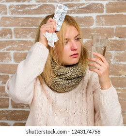 Headache and fever remedies. Take medications to reduce fever. What to know about breaking fever. Woman tousled hair scarf hold glass water and tablets blister. Girl suffer fever and take medicine.