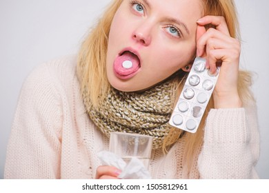 Headache and fever remedies. Woman sick person hold glass water and tablets blister. Take pills relieve fever. Drink plenty of fluids. Breaking fever concept. Girl take medicine to break fever.