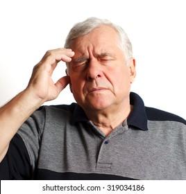 headache man aged. studio shot