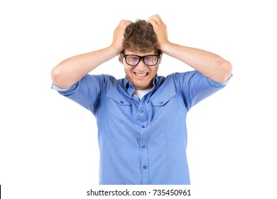 Headache. Man with glasses is holding his head.