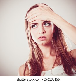 Headache, migraine and stress. Worried upset woman suffering from head pain or having high temperature.