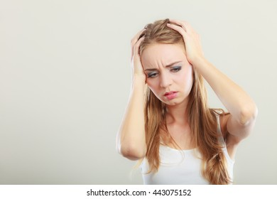 Headache, migraine and stress. Worried upset woman suffering from head pain